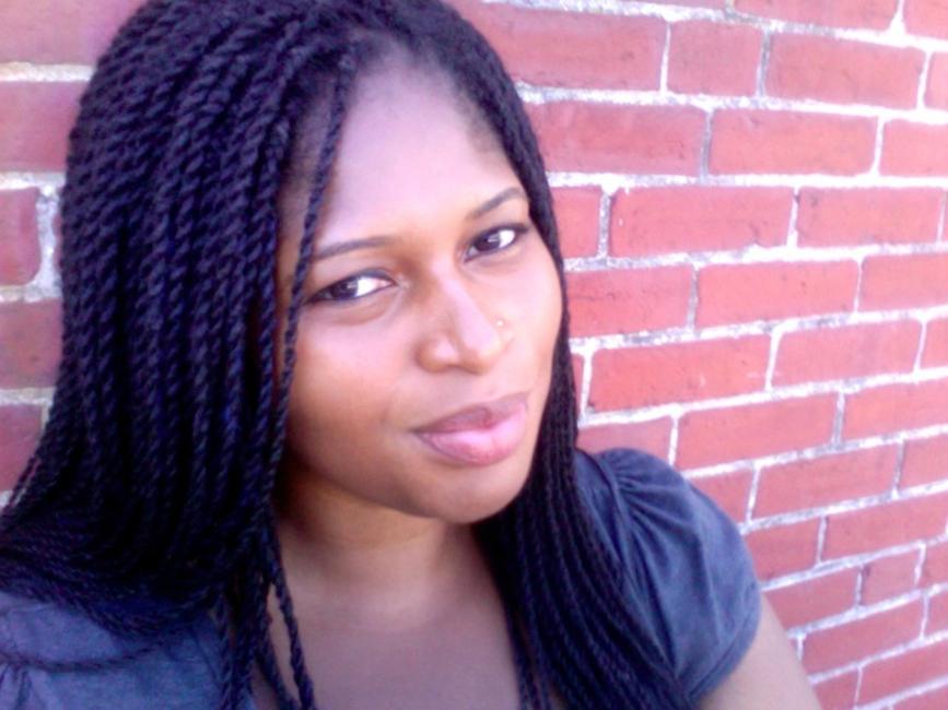 headshot, Mecca Sullivan Bio Photo - Brick Wall